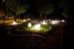 Kule świecące w Radlinie w oddali